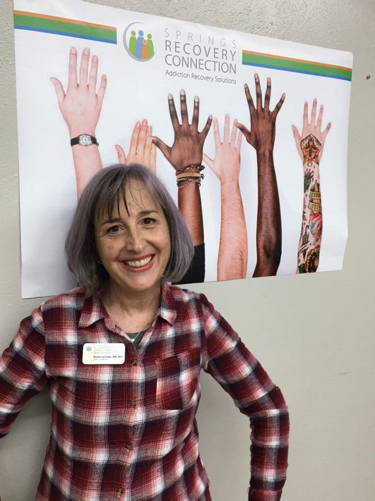 rebecca c in front of diverse hands image
