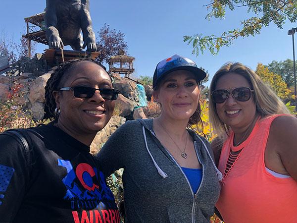 3 women posing outside