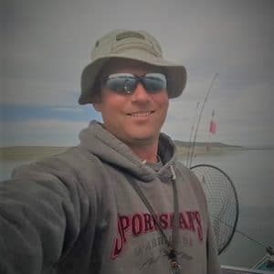male with fishing hat and sunglasses