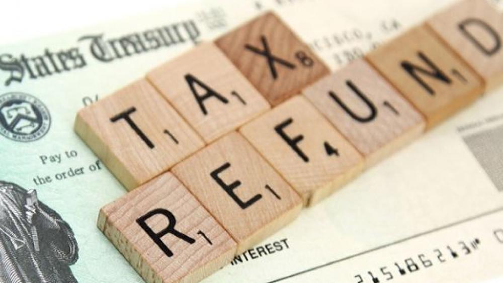 scrabble letters spelling out the word tax refund